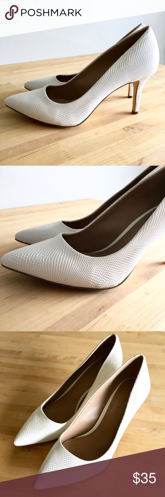 BCBG White Snakeskin Heels White heels with a snakeskin style texture from BCBGeneration. In great condition overall. Insides look like new! Small gay smudge above heel on right shoe, shown in pictures. TTS. BCBGeneration Shoes Heels