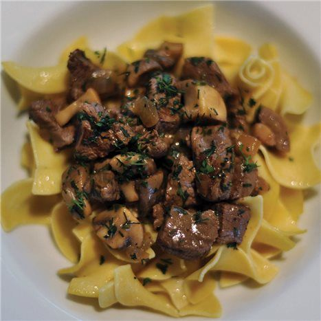 This is a cross between a traditional beef stroganoff and a quick-cooking stew, with plenty of room for adjustment: Add extra mustard, use fewer herbs, go with more red wine and less beef broth, or skip the brandy and use more broth. Consider the recipe a starting point.