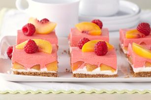 Creamy Layered Peach Squares  Dazzle friends with fresh peaches and raspberries atop layers of graham cracker, cream cheese, more peaches and raspberry mousse. We believe this is how you whip it good.