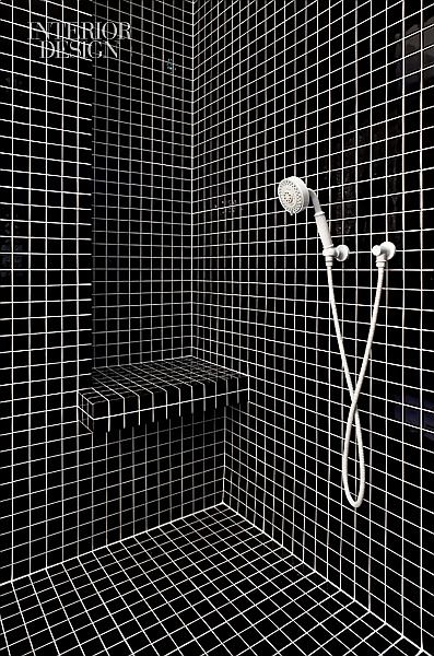 Once Upon a Tile: A Modern NYC Apartment by HWKN | Tile in the master bathroom's shower is 2-inch-square. #design #interiordesign #interiordesignmagazine #architecture #bathroom #tile