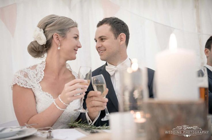 Cheers to getting married! Congratulations to the bride and groom. Check out other wedding photography by Anthony Turnham at www.snapweddingphotography.co.nz