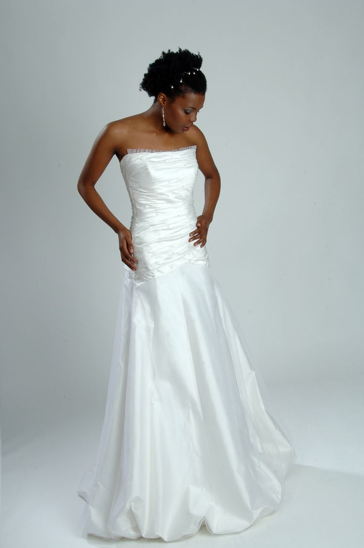 This gown has a rouched, beaded bodice - and it's for SALE!