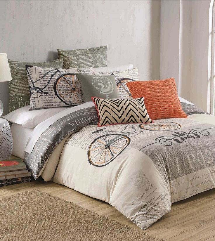 The retro bicycle print and the collage of vintage stamps lends a Parisian-chic vibe to a bedding that appeals to any wanderlust.