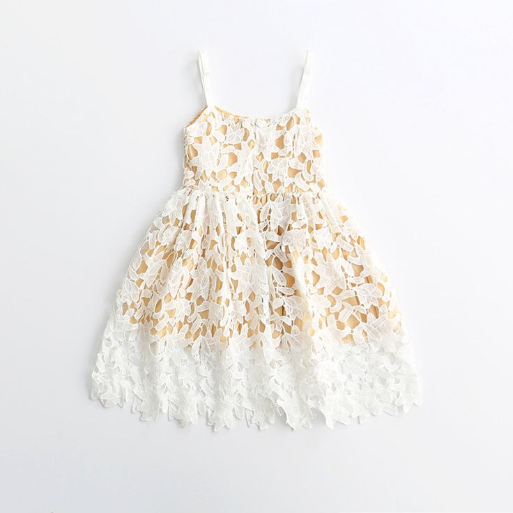 """A gorgeous eyelet dress with adjustable straps to create that perfect fit! Dress this one with our Kat Denim Jacket for a casual """"back to school"""" look or add some pearls for your next fancy luncheon!"""