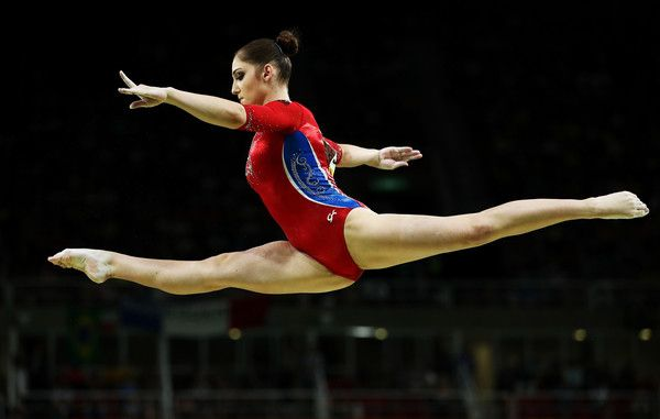 Aliya Mustafina Photos - Aliya Mustafina of Russia competes on the balance beam during the Artistic Gymnastics Women's Team Final on Day 4 of the Rio 2016 Olympic Games at the Rio Olympic Arena on August 9, 2016 in Rio de Janeiro, Brazil. - Gymnastics - Artistic - Olympics: Day 4