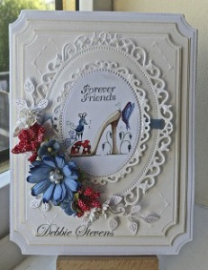 Ive used Spellbinders grand large labels as my base layers, SB floral ovals, In stitches embossing folder, the shoe image is from cd rom 'fabulous shoes' from Katy Sue Designs. The foliage die is from cheerylynne and is called ivy corner flourish. The cardstock Ive used is from annamarie designs called brushed satin.