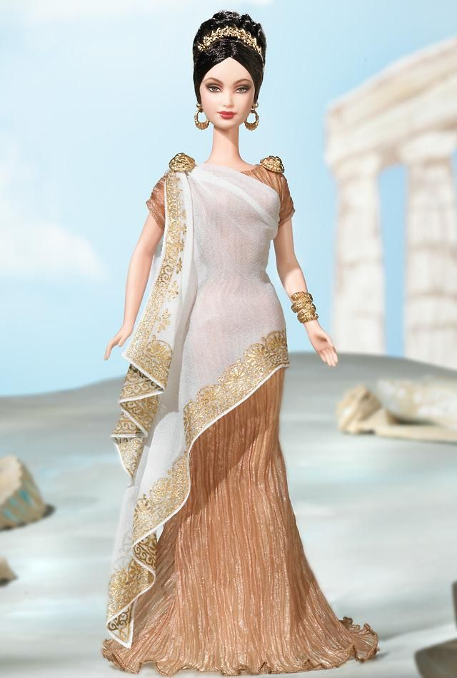 """""""Princess of Ancient Greece™ Barbie® Doll wears a rippled, copper-colored dress called a """"chiton"""" that flares at the bottom. A square sheer wrap decorated with a golden Grecian pattern is pinned at her right shoulder with one of two golden pins that are shaped in a lion's head. She wears a golden serpent arm cuff and completes her outfit with a golden laurel crown atop her curly dark brown hair, worn up in a classic Grecian chignon."""" I really love her expression.  She looks like Athena or som...: Greek Princesses, Barbie Collector, Barbie Girls, Greece Barbie, Gowns, Barbie Collection, Ancient Greece, Barbie Dolls, Brown Hair"""