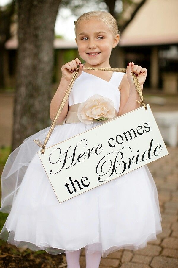 'Here comes the bride' sign held by flower girl
