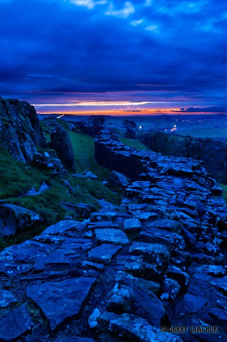 Hadrian's Wall at Walltown Crags in Northumberland at sunset. England
