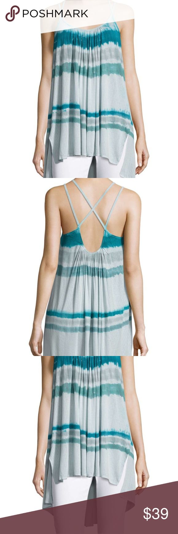 New Free People XS Stripe Blue Tie Dye Tank Top This is a Free People Blue Fly By Tank in Aquamarine Combo. Size: XS. Color: Blue. MSRP $78. NWT. * Tie dye stripes and strappy shoulders style the Fly Away Tank, cut from a rib knit so lightweight that you'll take flight. * Scoop neck * Sleeveless * Side vents * Hi-lo hem * Imported  * Made of 92% modal 8% rayon * Hand wash cold * Fit: this style fits true to size. Free People Tops