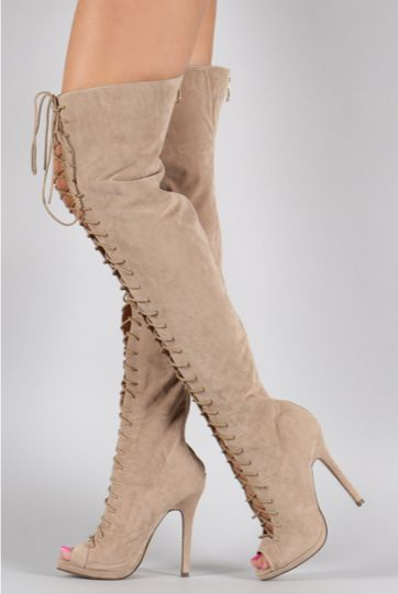 These stiletto thigh high boots feature a peep toe silhouette, lace up…