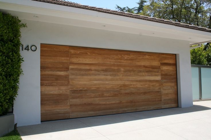 modern garage door - I like how the flat wood appearance of the garage door extends onto the house.