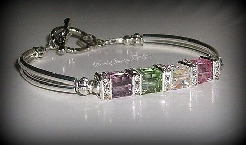 Birthstone Mothers Bracelet: Personalized Jewelry, Birthstone Jewelry, Custom Made Bracelet, Bracelets for Women, Birthstone Bracelet, Moms  This gorgeous bracelet is made with 6mm Swarovski Crystal AB, Light Amethyst, Light Rose and Chrysolite cubes. The cubes are centered by crystal squaredelles. Silver plated tube beads and a heart toggle completes this feminine bracelet.  Use the style of bracelet to CREATE YOUR OWN MOTHERS BRACELET...Simply state desired colors in the message to seller…