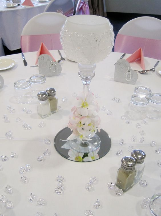 Pink & white wedding centerpieces with frangipani's