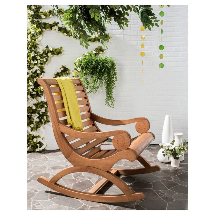 The porch rocker gets a glamour makeover in this outdoor rocking chair with transitional lines that update the profile of a British classic. Crafted of Eucalyptus wood in a teak brown finish, this piece is perfect reading, dozing or watching a sunset.