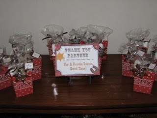 Cowboy Party Favors - trail mix packaged in a cute bandana box and sheriff badge attached