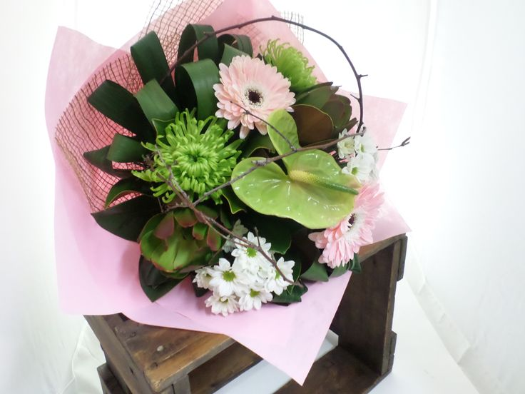 A beautiful combination of pinks and greens bouquet with interesting greenery