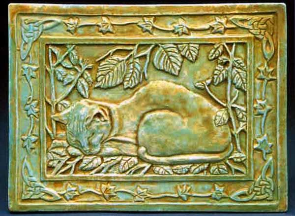 The Cat - Wall or Garden Plaque - This contented cat is lying on a bed of catnip plants, with witch hazel leaves overhead, and a border of ivy leaves and Celtic knots. A perfect gift for a cat lover. This plaque makes a wonderful memorial stone to be placed in your garden as a remembrance of a cat that has passed on.