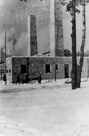 Auschwitz II-Birkenau. Construction of crematorium and gas chamber IV. The part of the building with two chimneys visible in the foreground is the crematorium part.