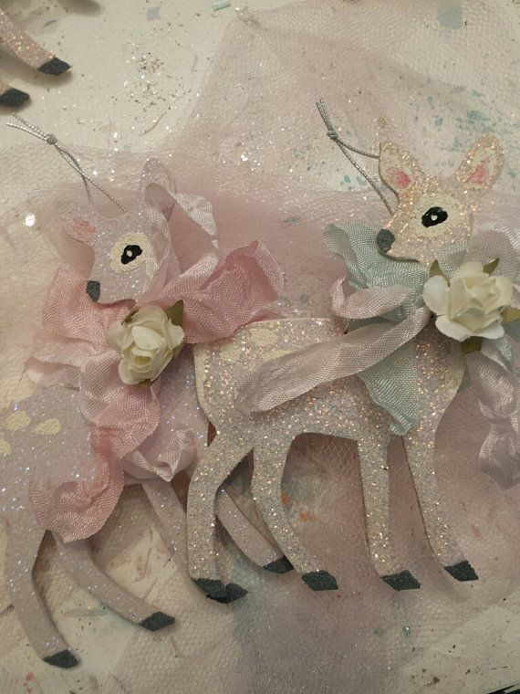 Hand painted and glittered deer ornament set of two. Size is approximately 4h x 2.5w. They have silver thread hangers attached. These are