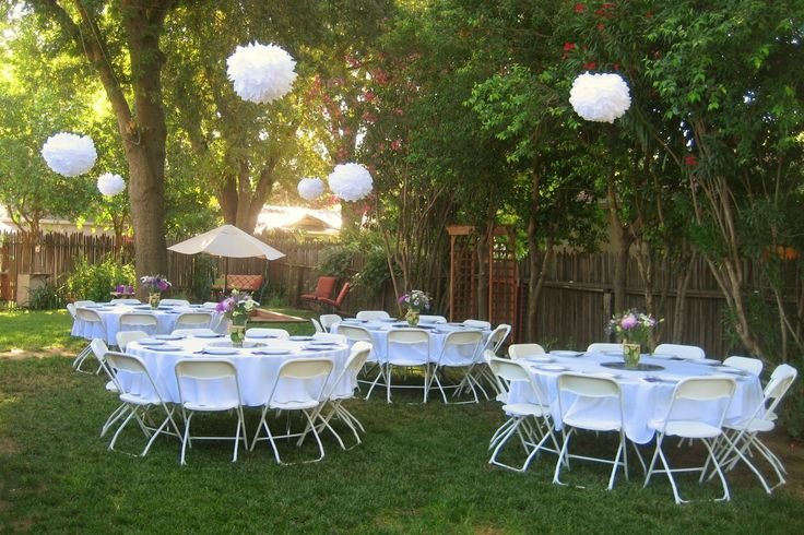white puff balls...the tissue paper kind. great way to decorate a backyard bridal shower