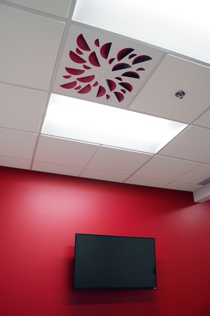 NEX-S Architectural Ceiling Diffuser with Red Concave Elements in a ceiling with red wall