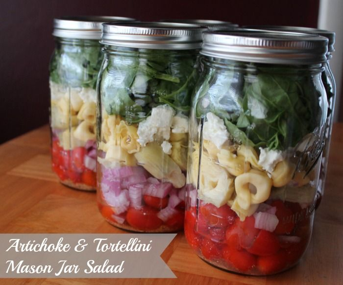 Mason Jar Salad with Tortellini,  Artichoke Hearts, Cherry Tomatoes, Red Onion, Italian Dressing, Goat Cheese with a Spinach and Arugula blend. Make ahead, meal prep convenience.