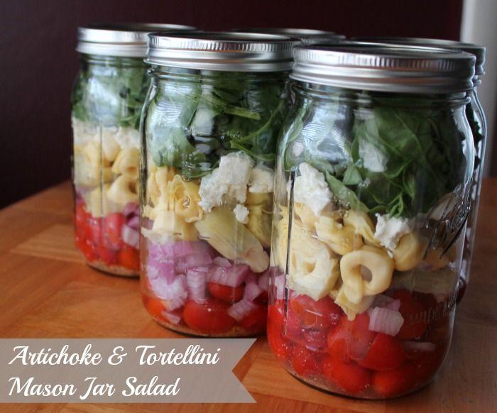 Mason Jar Salad. Artichoke, tortellini, goat cheese, arugula, spinach, red onion, and tomato. Delish! #masonjarsalad