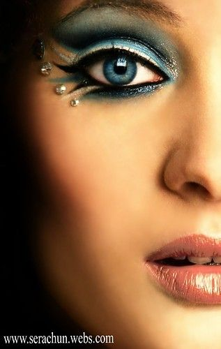 bird like eye makeup. Mermaid eye makup. Turquoise eye shadow with pearl gems as accents around eyes