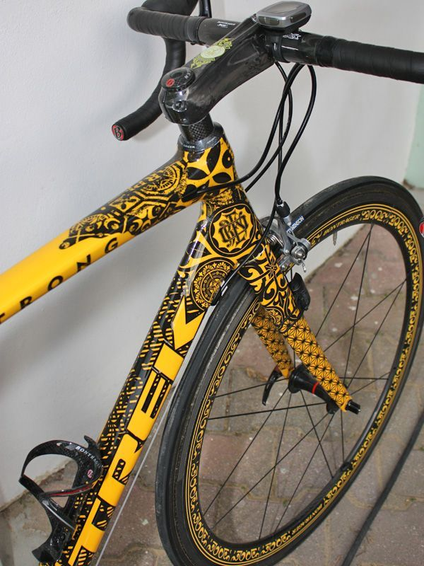 The incredibly detailed graphics are actually die-cut decals that are precisely positioned and trimmed over a uniform yellow base coat and then clear-coated over