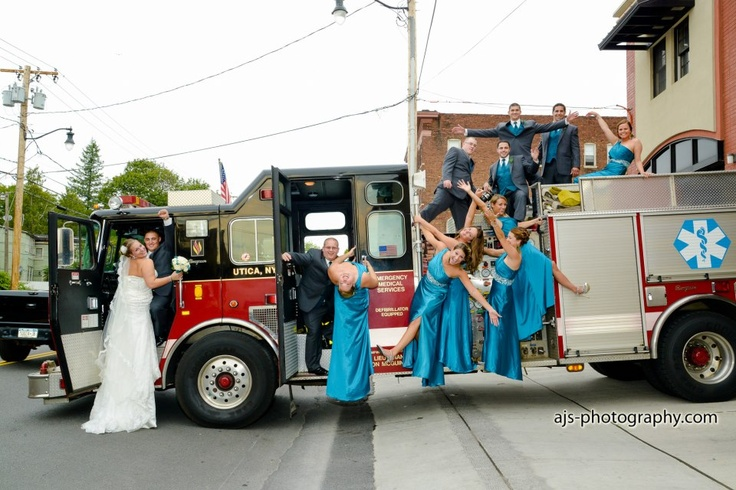 firefighter wedding fire truck. also like the color of the bridesmaid dresses