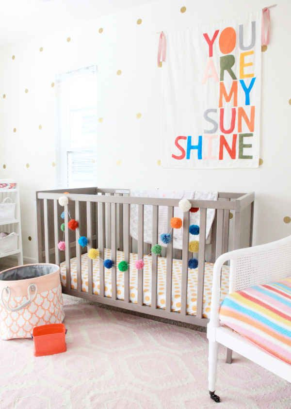 A mix of bright colors and patterns makes for a smile-inducing nursery.   Via Lay Baby Lay   - ELLEDecor.com