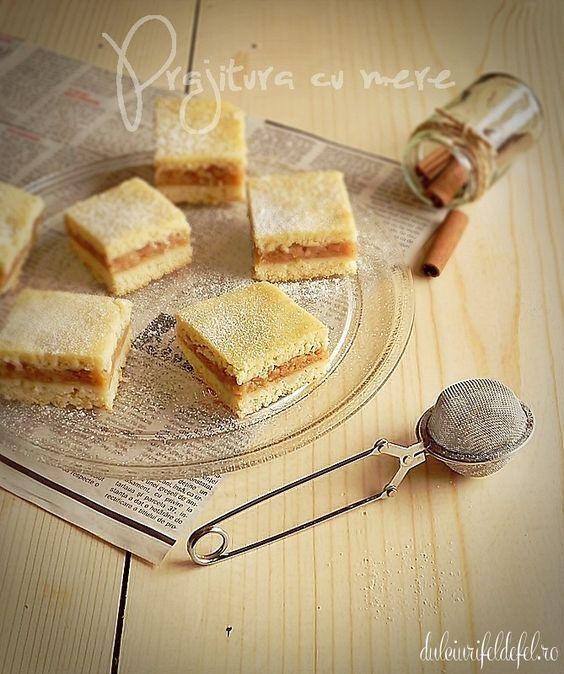 Mod de preparare Prajitura cu mere: Merele se curata de coaja (daca e necesar), se rad pe razatoarea cu ochiuri mari si se pun la calit cu zahar si unt. Se fierb pana scade zeama lasata, amestecand din cand in cand. Se aromeaza cu scortisoara dupa gust si se lasa…