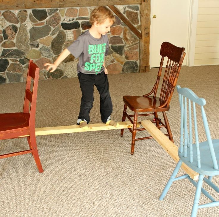 DIY balancing beam for preschoolers! Love the idea of using chairs and 2 by 4s!