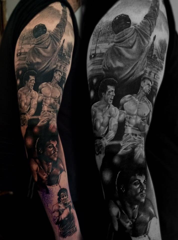 Rocky Balboa themed black and grey realistic sleeve tattoo.
