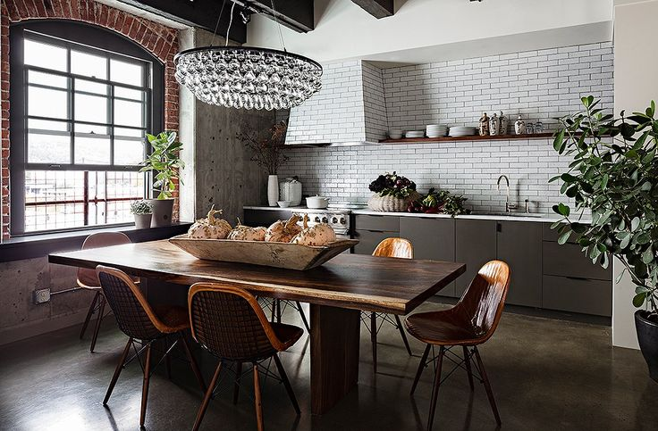 Gorgeous rustic-glam kitchen with sleek modern cabinets and a rustic farm dining table.