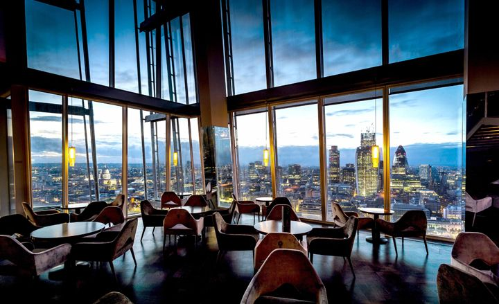 Aqua Shard at The Shard, 31st floor. A glamorous spot to admire many of London's iconic landmarks whilst sipping on a British-inspired cocktail or a glass of fizz. www.santiandquinn.com