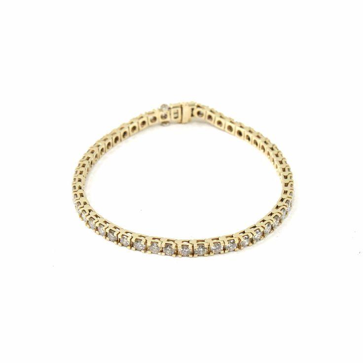 Bracelet non signé  - Rivière de diamants  - Or jaune 14 ct  - Avec 51 diamants taille brillants  - Total de environ 4.97 carats.  - Longueur 17 cm  - Avec un certificat d'origine