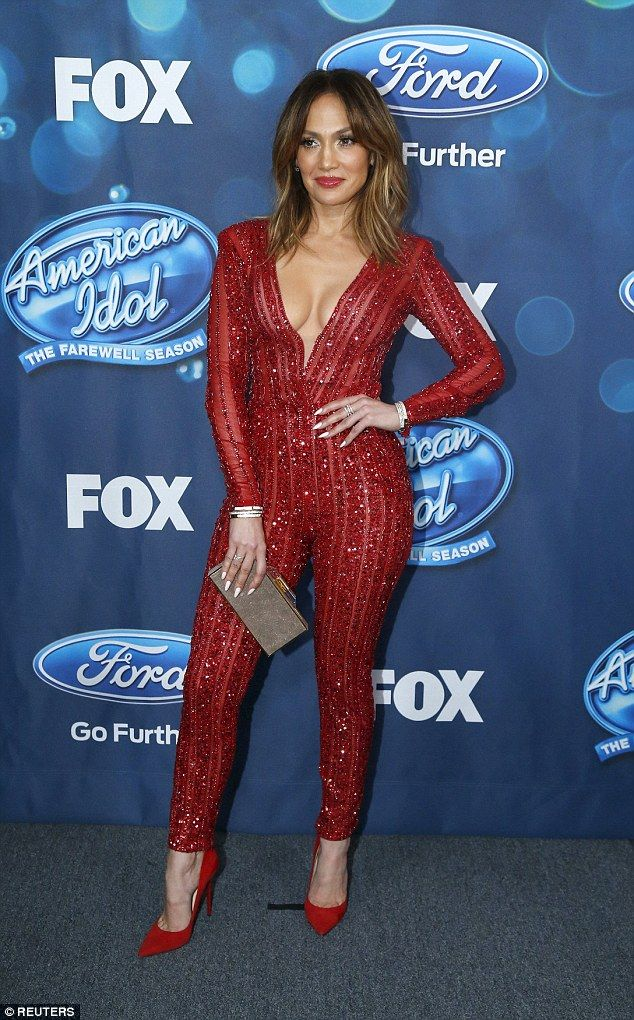 Lady in red: She showed off her decolletage in a sexy scarlet jumpsuit on Thursday's Ameri...