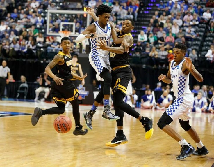 Kentucky guard De'Aaron Fox (0) and Northern Kentucky forward Jeff Garrett (4) collided as Fox loses the ball during UK's 79-70 win over the Norse in a first round NCAA tournament game in Bankers Life Fieldhouse in Indianapolis, In., Friday, March17, 2017.