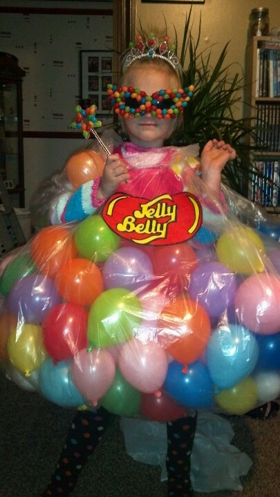 bag of jelly beans..shes the queen bean...Take a rain poncho and tie it at the bottom. (Two sided tape was used on shirt in this pic.) And stuff the poncho with balloons. Go online and print I u  jelly belly logo. (I colored it to make it darker). And I glued jelly beans to mask, crown and wand