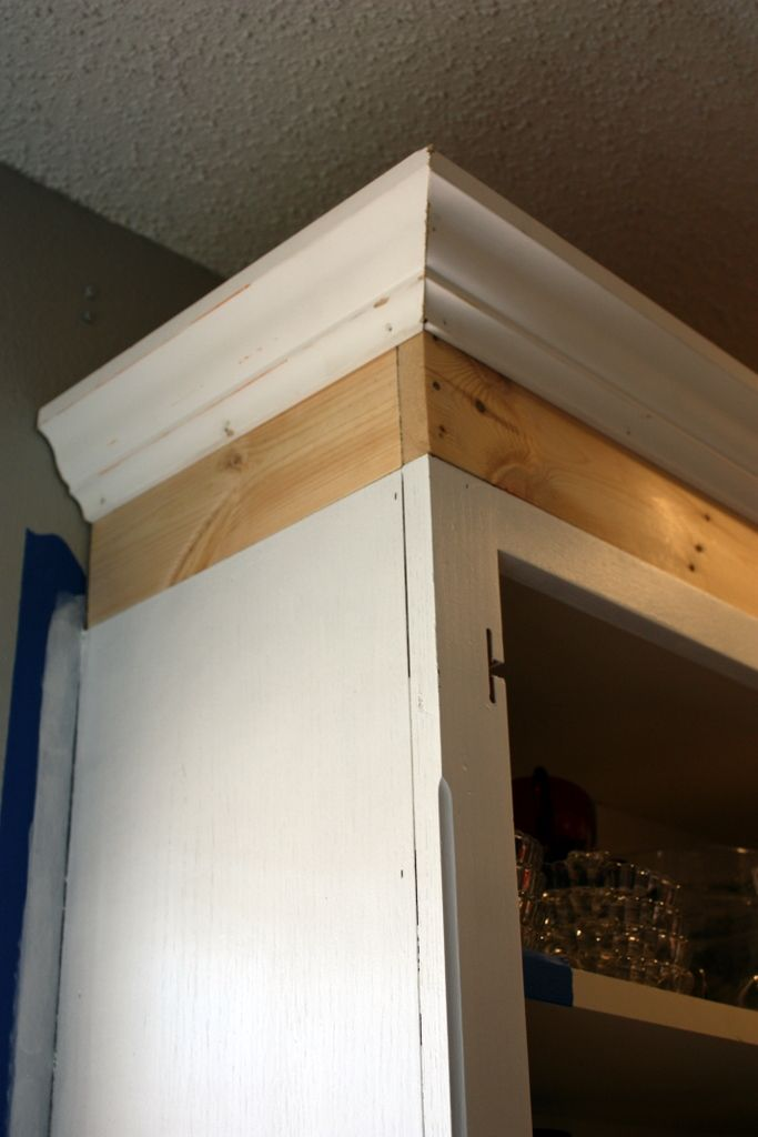 How to add height to your kitchen cabinets.  Love this idea.  Great DIY idea to make a dramatic impact for little cost.