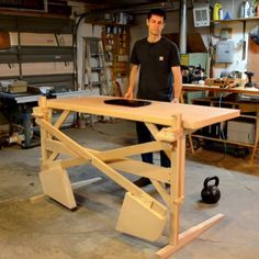 "Though trained as an engineer, Scott Rumschlag quit his engineering office job after less than a year due to his ""extreme dislike of sitting all day."" Now that he's switched to building things for a living, it's unsurprising that he's built himself an adjustable standing desk. What is surprising"