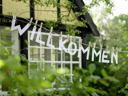 this little lovely is 'welcome' in German, but wouldn't it be the sweetest way to greet your guests in any language? #diy #party