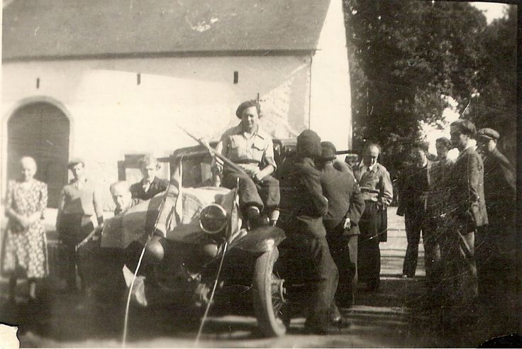 My father as a member of the Belgian Resistance in September 1944 - the liberation days - he is seated on his car with a rifle in his hands - taken somewhere near Arlon (Belgium)