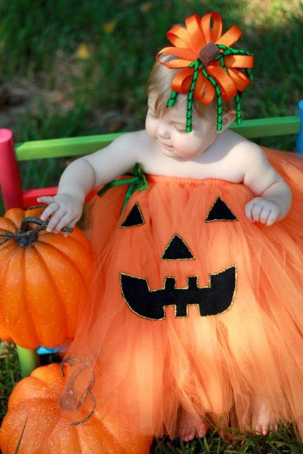 You should totally glue a pumpkin face on her Flower girl dress!!