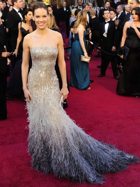 Hilary swank in gucci gown feather matter pinterest for Peacock feather wedding dress vera wang 2009