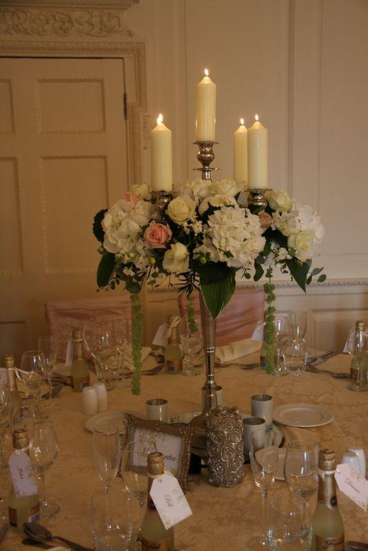 Baroque style candelabras overflowing with Roses, Hydrangeas, Peonies, Philadelphus Snowbelle, Hostas, Eucalyptus and trailing Amaranthus