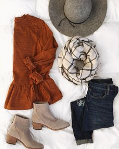 fall outfit- love this! Orange sweater with ruffle, skinny jeans, cute booties, White and black plaid scarf and adorable hat