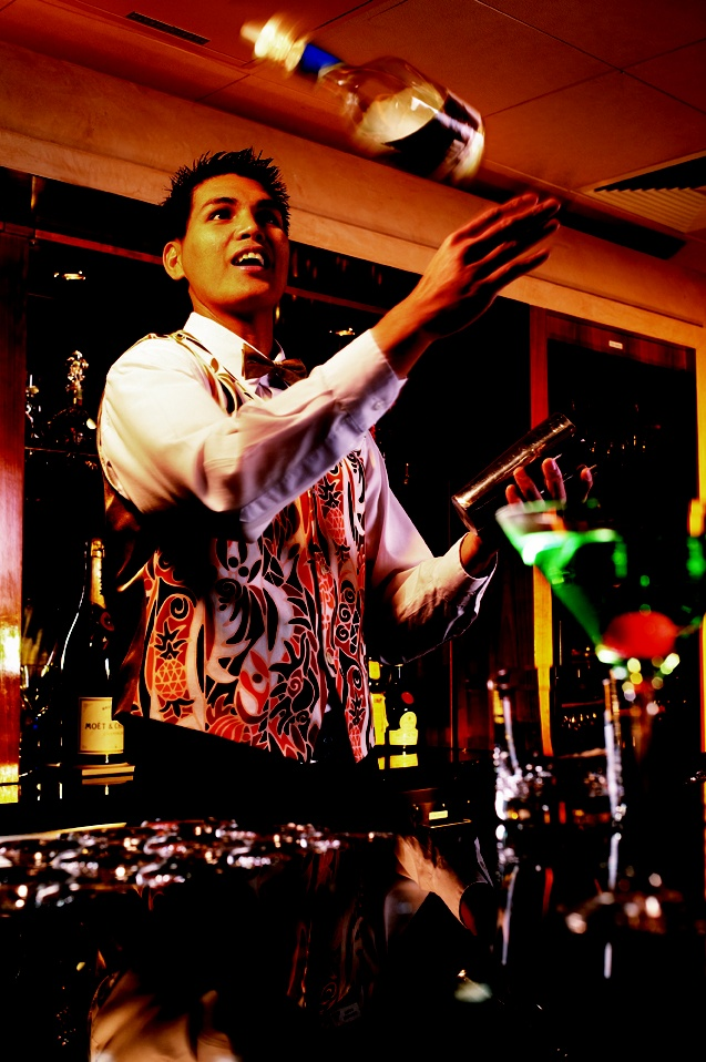 Bar tenders entertaining guests with Flair Bartending :D